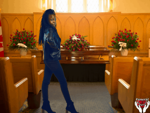 Woman wearing black jeans to a funeral