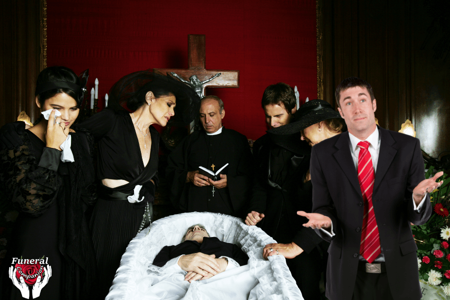 man not crying at a coffin