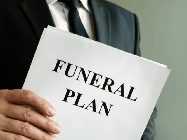 man holding a funeral plan
