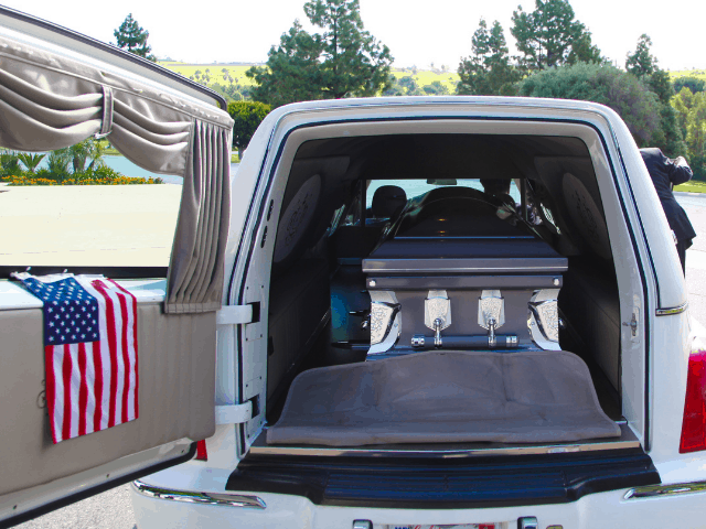 hearse with a coffin in it